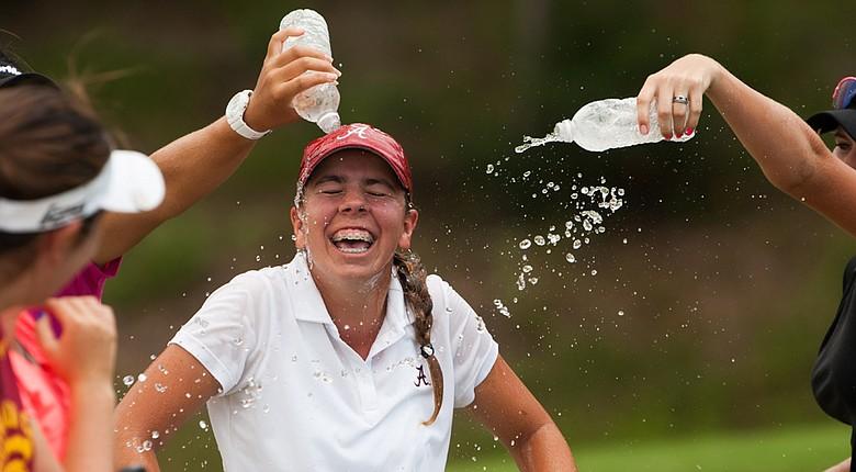 Kristen Gillman is sprayed with water bottles after winning the 2014 Junior PGA Championship.