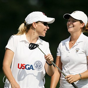 Ally McDonald shares a laugh with her college coach, Leigh Phillips, of Mississippi State at the 2014 U. S. Women's Amateur at Nassau Country Club.