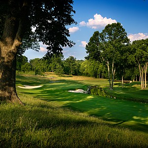 Hole No. 15, Par 4, 435 yards: Valhalla has a fine collection of par 4s, and this one starts a great three-hole stretch of them. The drive through a tree-lined chute is one of the tightest at the club and requires a careful right-to-left swing to avoid sand right (294 yards to reach, 313 to carry) and dense woods the entire left side. From there, the short-iron approach is to a green that's been nudged down towards a rocky creek bed, with the right side of the putting surface hanging over the water. The tendency is to tug the approach shot left, but that brings into a play a bunker pitched back toward the green and a slope that carries the ball toward the water.