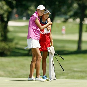Eimi Koga hugs her caddie/sister, Jennifer, after their round at the 2014 U. S. Women's Amateur at Nassau Country Club.