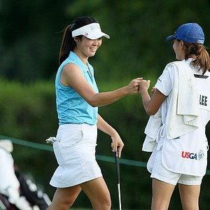 Erynne Lee makes birdie at No. 18 during the 2014 U. S. Women's Amateur at Nassau Country Club.
