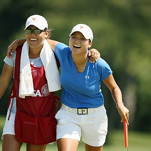 Grace Na shares a laugh with her caddie Lauren Diaz-Yi at the 2014 U. S. Women's Amateur at Nassau Country Club. Yi withdrew from the 114th Women's Amateur.