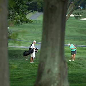 Margaret Shirley hits from the right rough at No. 18 during the 2014 U. S. Women's Amateur at Nassau Country Club.