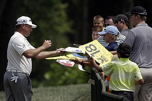 Fans interact with Lee Westwood on Tuesday at Valhalla before the 2014 PGA Championship.