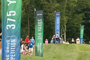 Fans watch a long-driving contest Tuesday at Valhalla before the 2014 PGA Championship.