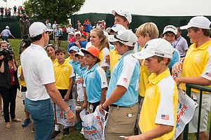 Rory McIlroy speaks with juniors Tuesday at Valhalla before the 2014 PGA Championship.