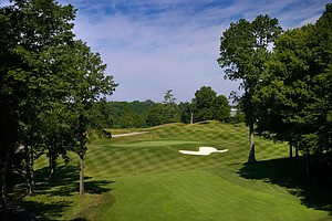 "Hole No. 12, Par 4, 467 yards: I'm all for hole names, but not when they're lifted from Charlton Heston films. You figure at a club called Valhalla there'd be a hole named ""Odin's Revenge."" Enough said. It's actually a beautiful par 4, very tough all the way thanks to a narrow driving zone carved left-to-right through a tree-lined chute and leaving a long second shot uphill over a cleaned-out ravine. There's great spectator viewing from behind this hole. Most players will lay up off the tee rather than risk running through the fairway (310 yards to the edge, downhill) or missing it altogether."