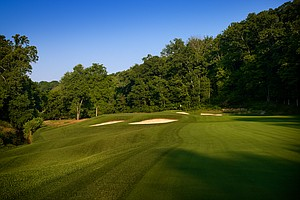 Hole No. 2, Par 4, 500 yards: For championship play, this members' par 5 is set up as a gut-wrenching par 4. The drive plays to a Barbie-doll waist of a fairway pinched to 22 yards across, with sand right and a steep falloff to the creek on the left. It's 280 yards to the bunker, 305 yards to clear, and with the watery slope looming left it won't be unusual to see players lay up short off the tee here and leave themselves a second shot from 230 yards out. The green, well defended up front and canted diagonally, offers less depth in the target zone than most par 4s at Valhalla. It's a hole that players, even of this caliber, will approach very defensively.