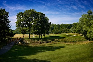 "Hole No. 3, Par 3, 205 yards: It's impressive how basic and solid Nicklaus can design holes when he's not trying to trick folks up with gimmicky green ""quadrants."" There's an elegant flow to this hole, especially as viewed from the slightly elevated platform tee across the creek at the base of the wooded hill. A very deep bunker flanks the entire right side and tends to draw golfers away to the left – where the green tilts ever so slightly away from the line of play. The point here is that players have to commit to a middle iron that starts off closer to the right edge than their instincts would prefer."