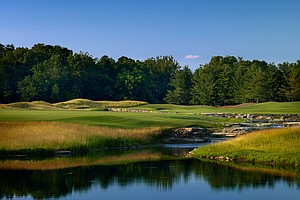 Hole No. 7: Par 5, 597 yards: The hardest thing in modern course design is to build a par 5 with a viable second fairway option.  Here's an example: a massive par 5, played from a deep launch pad, with two options staring you in the face. There's a long emerald road down the right side – a seemingly rational path studded with sand on the left side of the tee-shot landing area and on the right side protecting the second-shot zone. And then there's this little island of repose, virtually dead flat, rimmed only by rough, 1 acre in size and offering a considerably shorter helicopter pad of a fairway for someone who drives the ball 300 yards and straight. To say this island of a second fairway leaves you somewhat isolated is no exaggeration, especially if you miss it. But it is tempting, especially for a player who can then fly his second shot 250 yards over the odd combination of marsh and exposed rock that protects the flyway into this putting surface. The right side is certainly more mundane, but it does pinch down options such that a third shot in following a layup is very awkward because it poses threats both short (sand) and the length of the left side (water). Let's just say this will be an exciting hole to watch, given the rather startling range of options and the likely gamut of scores, from 3 through 8.