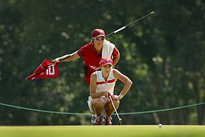 Gaby Lopez with her Arkansas head coach, Shauna Estes-Taylor during the round of 64 at the 2014 U. S. Women's Amateur at Nassau Country Club.