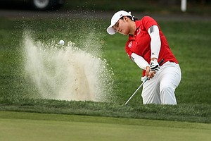 Marijosse Navarro hits a bunker shot during the round of 64 at the 2014 U. S. Women's Amateur at Nassau Country Club.