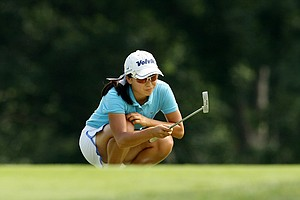 Mika Liu lines up a putt at No. 10 during the round of 64 of the 2014 U. S. Women's Amateur at Nassau Country Club.