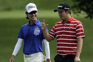 Kevin Na (left) and John Hah during Wednesday's practice round of the 2014 PGA Championship at Valhalla.