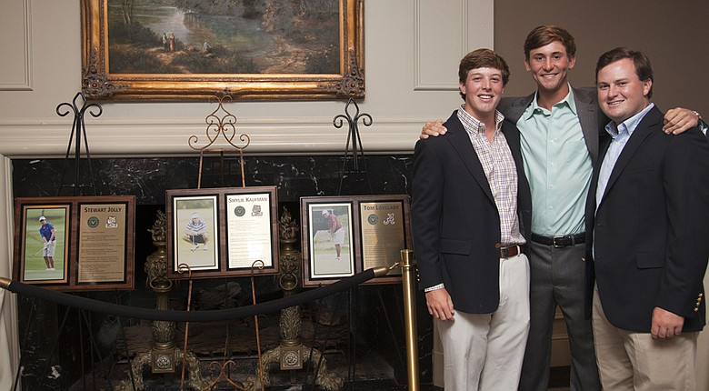 LSU teammates Stewart Jolly (from left) and Smylie Kaufman and Alabama's Tom Lovelady pose with commemorative plaques presented by the club Monday night in the Vestavia Hills section of Birmingham.