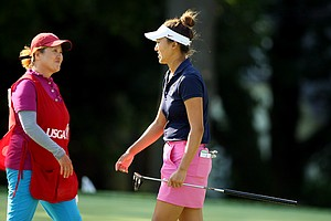 Annie Park with her mom/caddie, Young Park, at the 2014 U. S. Women's Amateur at Nassau Country Club. Park did not advance to match play.