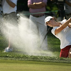 Emma Talley hits a bunker shot at No. 1 during exra holes of the round of 64 at the 2014 U. S. Women's Amateur at Nassau Country Club. Talley defeated Jiyoon Jang to advance.