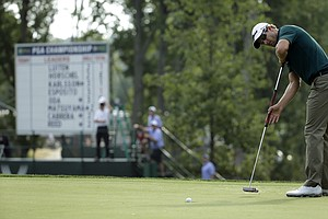 Adam Scott putts on the 11th hole during the first round of the PGA Championship at Valhalla.