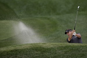 Ian Poulter hits out of the bunker on the ninth hole during the first round of the PGA Championship at Valhalla.