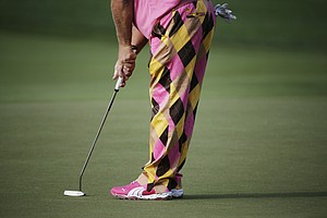 John Daly putts on the first hole during the first round of the PGA Championship golf tournament at Valhalla.
