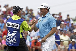 Lee Westwood with his caddie after firing a 6-under par first round of the PGA Championship at Valhalla.