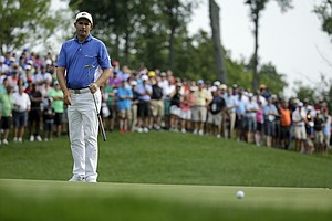 Padraig Harrington putts on the 11th hole during the first round of the PGA Championship at Valhalla.
