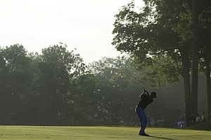 Robert Karlsson hits from the fairway on the 10th hole during the first round of the 2014 PGA Championship.