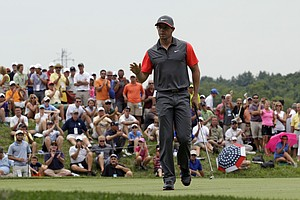Rory McIlroy waves after a birdie on the fourth hole during the first round of the PGA Championship at Valhalla.