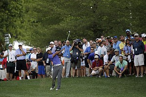 Tiger Woods hits from rough on the 10th hole during the first round of the PGA Championship at Valhalla.