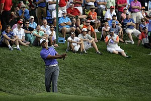 Tiger Woods hits a chip on the 11th hole during the first round of the PGA Championship at Valhalla.