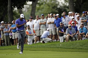 Tiger Woods reacts to his shot from the fairway on the 12th hole during the first round of the PGA Championship.
