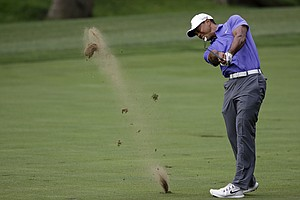 Tiger Woods hits from the fairway on the 15th hole during the first round of the PGA Championship at Valhalla.