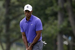 Tiger Woods reacts to his putt on the 11th hole during the first round of the PGA Championship at Valhalla.