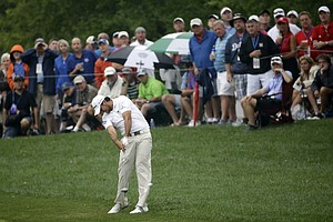 Jason Day hits from rough on the 10th hole during the second round of the PGA Championship at Valhalla.