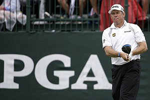Lee Westwood watches his tee shot on the first hole during the second round of the PGA Championship.