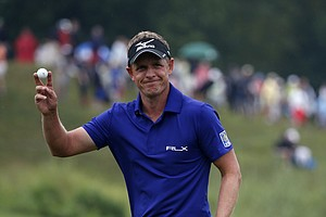 Luke Donald waves on the 18th green during the second round of the PGA Championship at Valhalla.