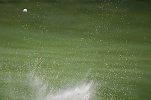 Matt Jones hits out of the bunker on the 18th hole during the second round of the PGA Championship at Valhalla.