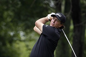 Phil Mickelson watches his tee shot on the second hole during the second round of the PGA Championship.