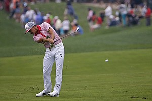 Rickie Fowler hits from the fairway on the 10th hole during the second round of the PGA Championship.