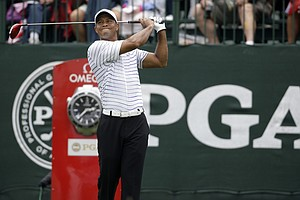 Tiger Woods watches his tee shot on the first hole during the second round of the PGA Championship at Valhalla.