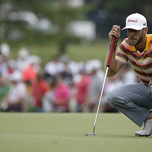 Graham Delaet lines up his putt on the first hole during the third round of the 2014 PGA Championship.