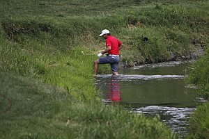 Jason Day crosses the water on the second hole during the third round of the PGA Championship at Valhalla.