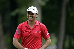 Jason Day smiles has he walks off the second green during the third round of the PGA Championship.