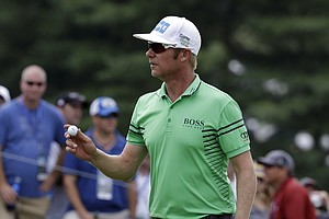 Mikko Ilonen waves after his putt on the ninth hole during the third round of the PGA Championship.