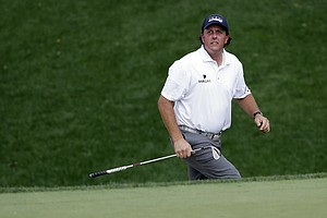 Phil Mickelson looks over his bunker shot on the 12th hole during the third round of the PGA Championship.