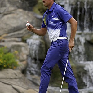 Rickie Fowler reacts after making a birdie on the 13th hole during the third round of the PGA Championship.