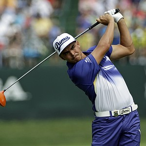 Rickie Fowler watches his tee shot on the fifth hole during the third round of the PGA Championship.