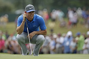 Rory McIlroy lines up his putt on the first hole during the third round of the PGA Championship at Valhalla.