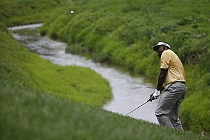 Vijay Singh hits a chip on the second hole during the third round of the PGA Championship at Valhalla.