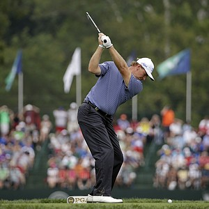 Ernie Els hits his tee shot on the eighth hole during the final round of the PGA Championship at Valhalla.
